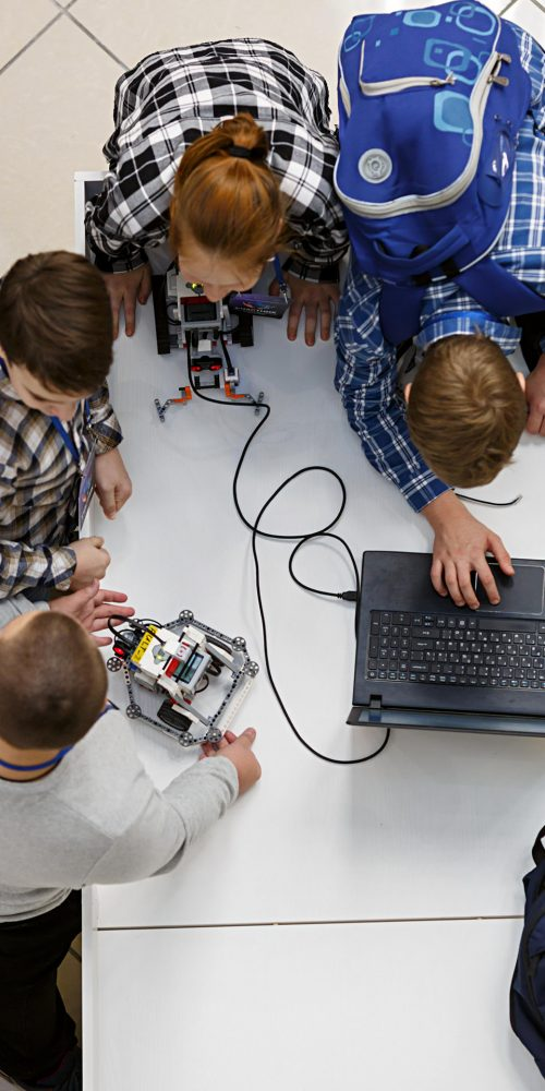 Group of children with laptop, programming the robot at robotics competitions / Photo credits: Balakate / 2017 / Source: depositphotos.com, ©2019