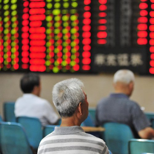 A Chinese investor looks at prices of shares (red for price rising and green for price falling) at a stock brokerage house in Nanjing city, east China's Jiangsu province / Photo credits: Imaginechina-Editorial / 2018 / Source: depositphotos.com, ©2019