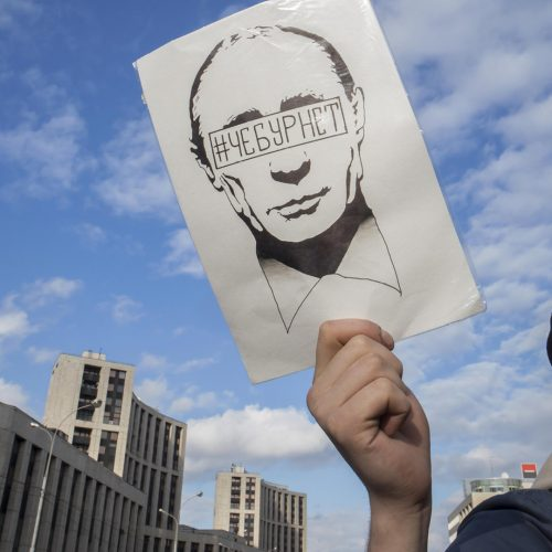 Sakharov Prospect. Political rally for free Internet. Youth with political poster with Putin face / Photo credits: elenarostunova / 2019 / Source: depositphotos.com, ©2019