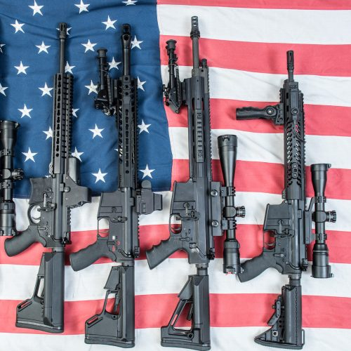 A collection of AR-15's on an American flag / Photo credits: homank76 / 2018 / Source: depositphotos.com, ©2019