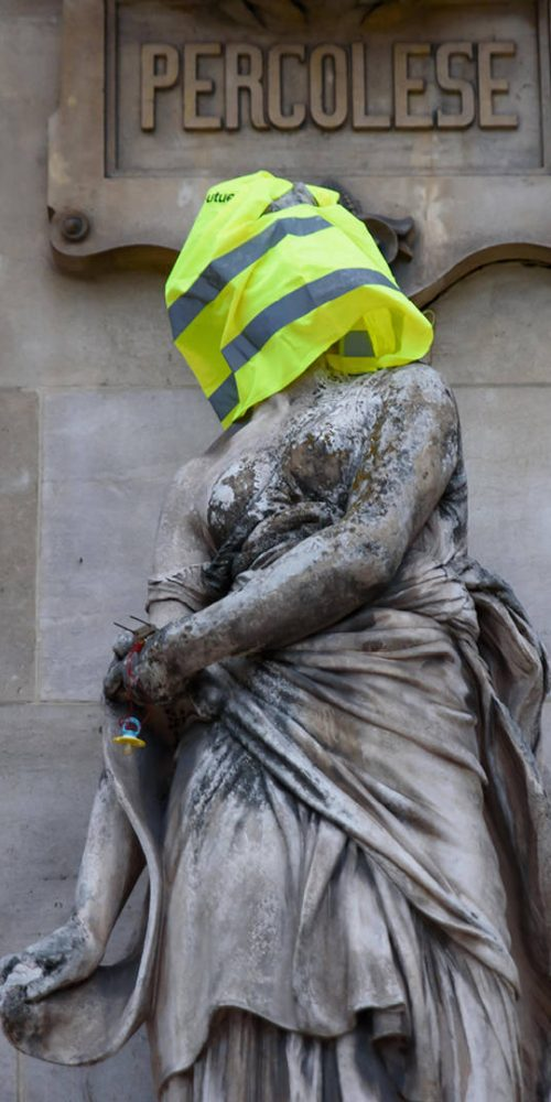 Protesters of Yellow Vests demonstration (Gilets Jaunes) against fuel tax, government, and French President Macron put yellow vest and flag on Paris Opera Garnier. Paris, France. / Photo credits: momo11353@hotmail.coma / 2018 / Source: depositphotos.com, ©2019
