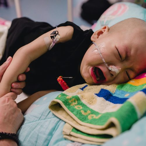 2-year-old Chinese boy Hu Haoyang diagnosed with hepatoblastoma is looked after by his grandmother at the Bayi Children's Hospital in Beijing, China / Photo credits: Imaginechina-Editorial / 2015 / Source: depositphotos.com, ©2019