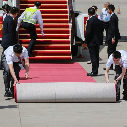 Chinese workers prepare as a plane carrying Ethiopian Prime Minister Hailemariam Desalegn arrives at the VIP terminal of Beijing Capital International Airport ahead of the Belt and Road Forum for International Cooperation in Beijing, China / Photo credits: Imaginechina-Editorial / 2019 / Source: depositphotos.com, ©2019